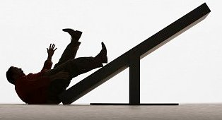 After losing his balance, an elderly man falls down a staircase.